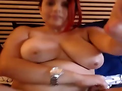 Big-titted lassie fingers her coochie on webcam
