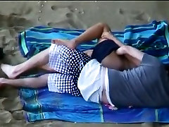 Beach candid camera shows slut having sex