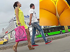 Hot upskirts with slender brunette in yellows dress
