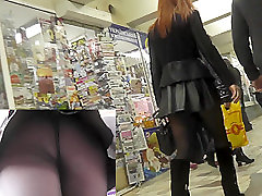 MILF with her boyfriend in the public upskirts