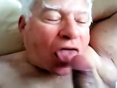 A gray-haired old fes iman sucking another man&039;s cock