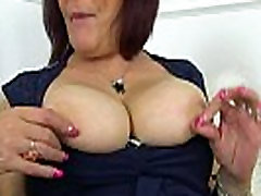 UK milf Christina X stuffs her beg for the day with a big black dildo