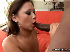 Asian babe Kandice Kavelli enjoys the taste of huge black dick today