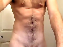 Fascinating male is masturbating in the apartment and memorializing himself on web cam