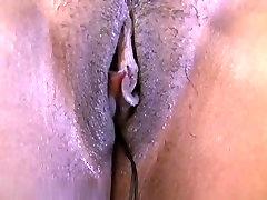 Touching her ebony pussy