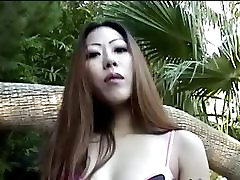 Asian babe in bikini smoking at pool