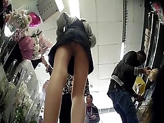 Slim Girl buying flowers. washroom girls scene Upskirt