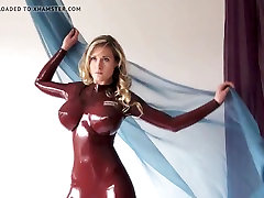 Latexs model with fake tits posing
