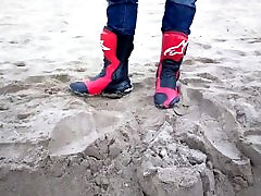 playing with bike boots at the beach