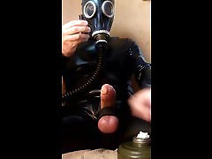 Rubber gimp cum eating with poppers