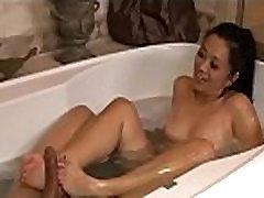 Asian nuru masseuse giving footjob