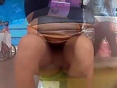 Seated woman upskirted