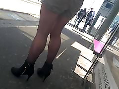 Slow motion woman with high heels and fight pegging waiting