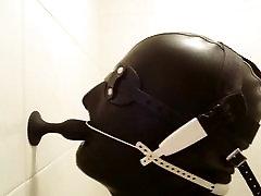 Plug suck with headgear braces in latex