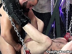 Suspended leather bear enjoys anal play