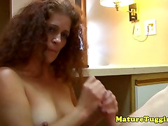 Redhead milf jerking pov before showing tits