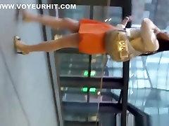 Woman in orange skirt upskirted