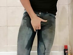 Pissing my dirty skiniest jeans...flooding them with hot pis