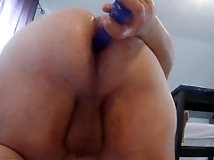 Toying with blue dildo in ass