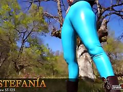 Hot girl in rubber tights shows her pussy