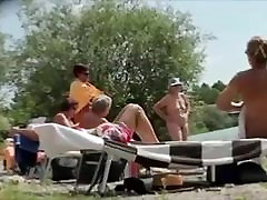 matures suntanning naked
