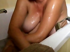 hidden cam unaware MILF hotel bathroom