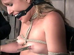 Sluttishly looking blonde Sasha Heart is tied up and punished in the camille crimson blowjob room