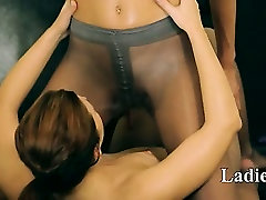 Two sweaty holes in nylon pants on bed