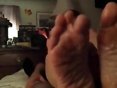 Mature brunette footjob