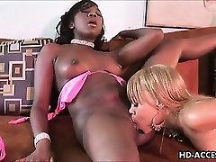 Ebony lesbians fuck with dildos