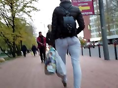 MILF with tight round ass in the street