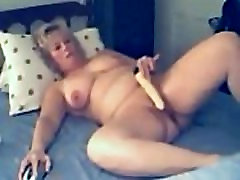 mature xxx video behatin pleases her cunt with vibrator on webcam
