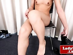Teasing ladyboy playing with her stiff dick