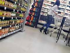 Shopper in blue pantyhose with pleated skirt