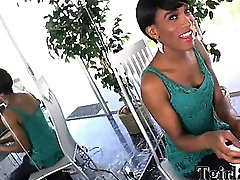 Ebony shemale with a small fake tits and a semi short hair strips off her lingerie and then masturbates