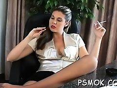 Dirty slut ravishing her stud while smoking a cigarette
