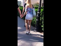 74 Blonde girl with sexy legs in white mini skirt