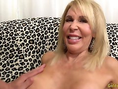 Mature blonde Erica Lauren shows off her bathtub fist and fucks