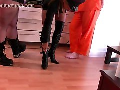 Kinky leather clad femdoms make slave lick their boots clean