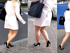 80 Blonde girl with butt fatt legs in mini skirt and high heels