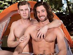 Hot men having lusty gay sex outdoor
