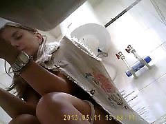 Some Girl pissing in toilet in office
