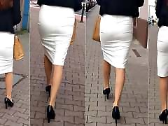 92 Girl with boobs test legs in tight skirt and high heels