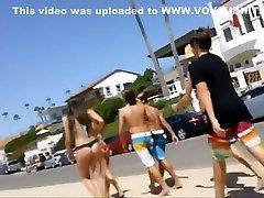 Following girls in thong bikinis to beach