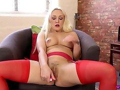 Rapacious UK MILF Amber Deen wears all red stuff and masturbates herself