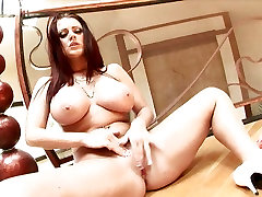 Big boobed Sophie Dee fondles her smooth pussy to orgasm
