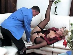 Ebony slut in black fishnet stockings sucks cock