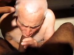 Daddy Sucking a Huge Black Cock