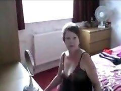 Sexy uk milf slut dressing in front of window