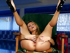 Zoe blows a load when she rams some dildos in her tight snatch